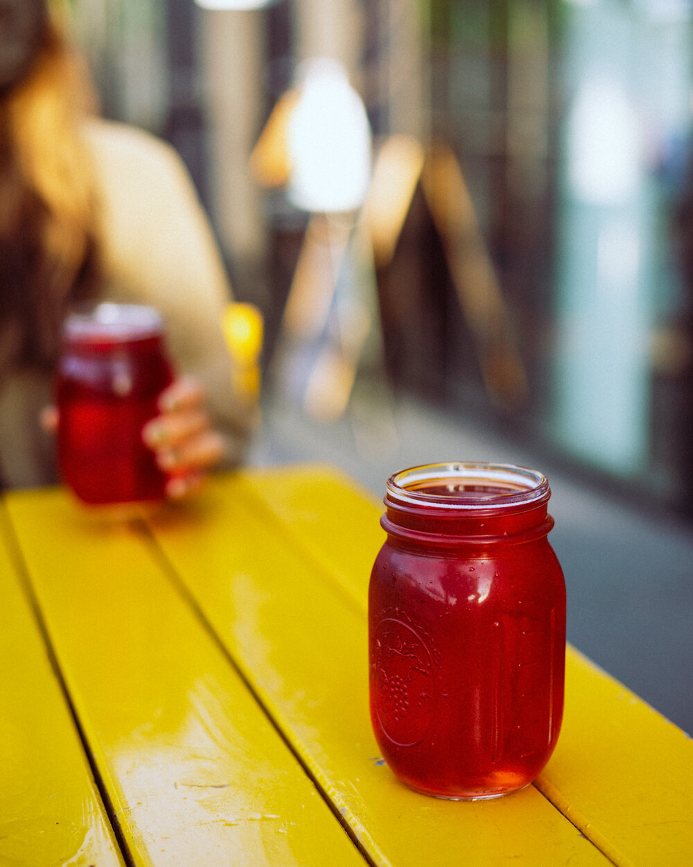 Rachel Off Duty: Two Bright Pink Beers in Mason Jars on a Yellow Table
