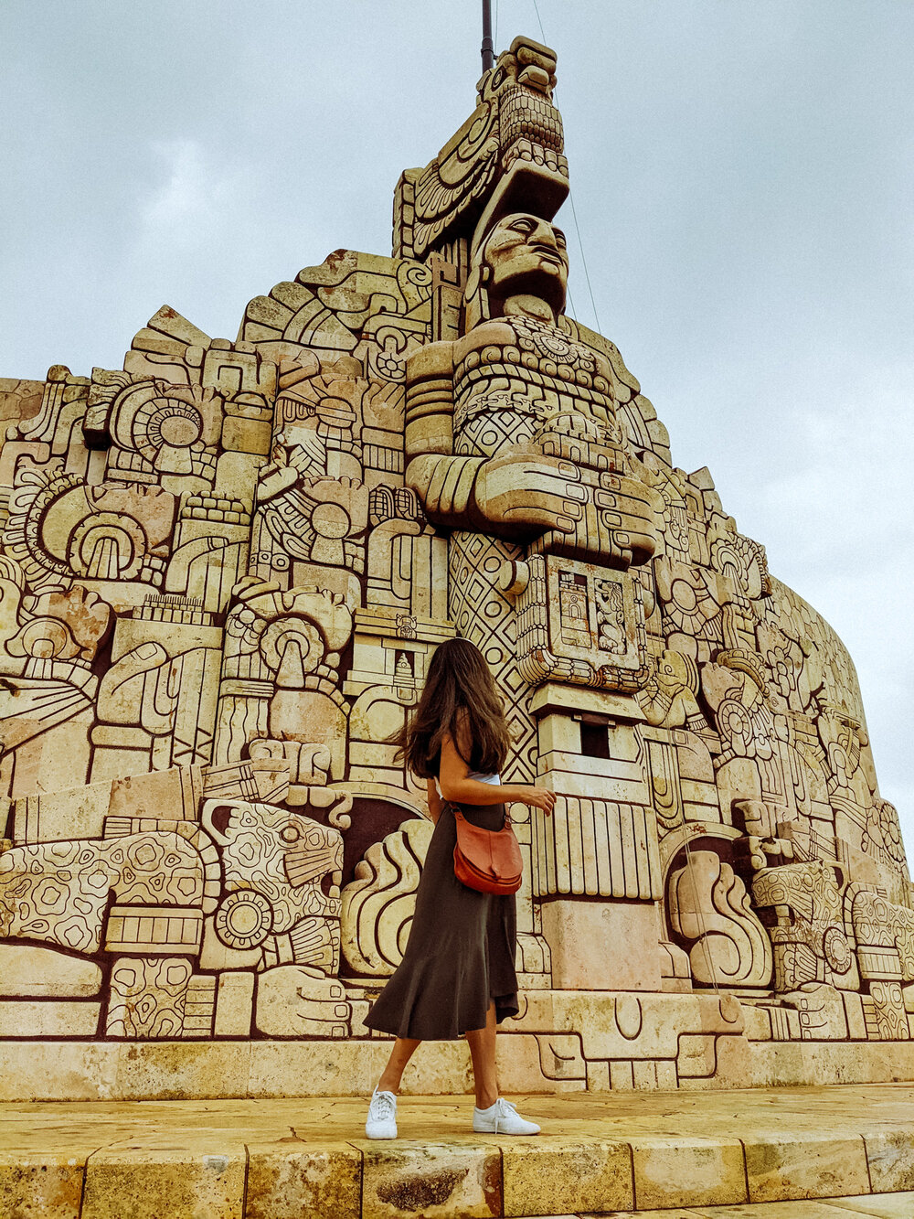 Rachel Off Duty: A Woman Standing in Front of the Monumento a la Patria, Merida