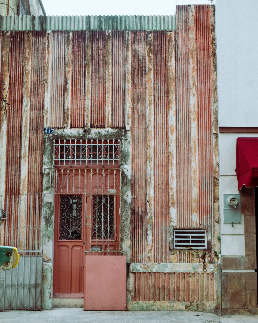 Rachel Off Duty: A Pink and White Striped Building in Merida, Mexico