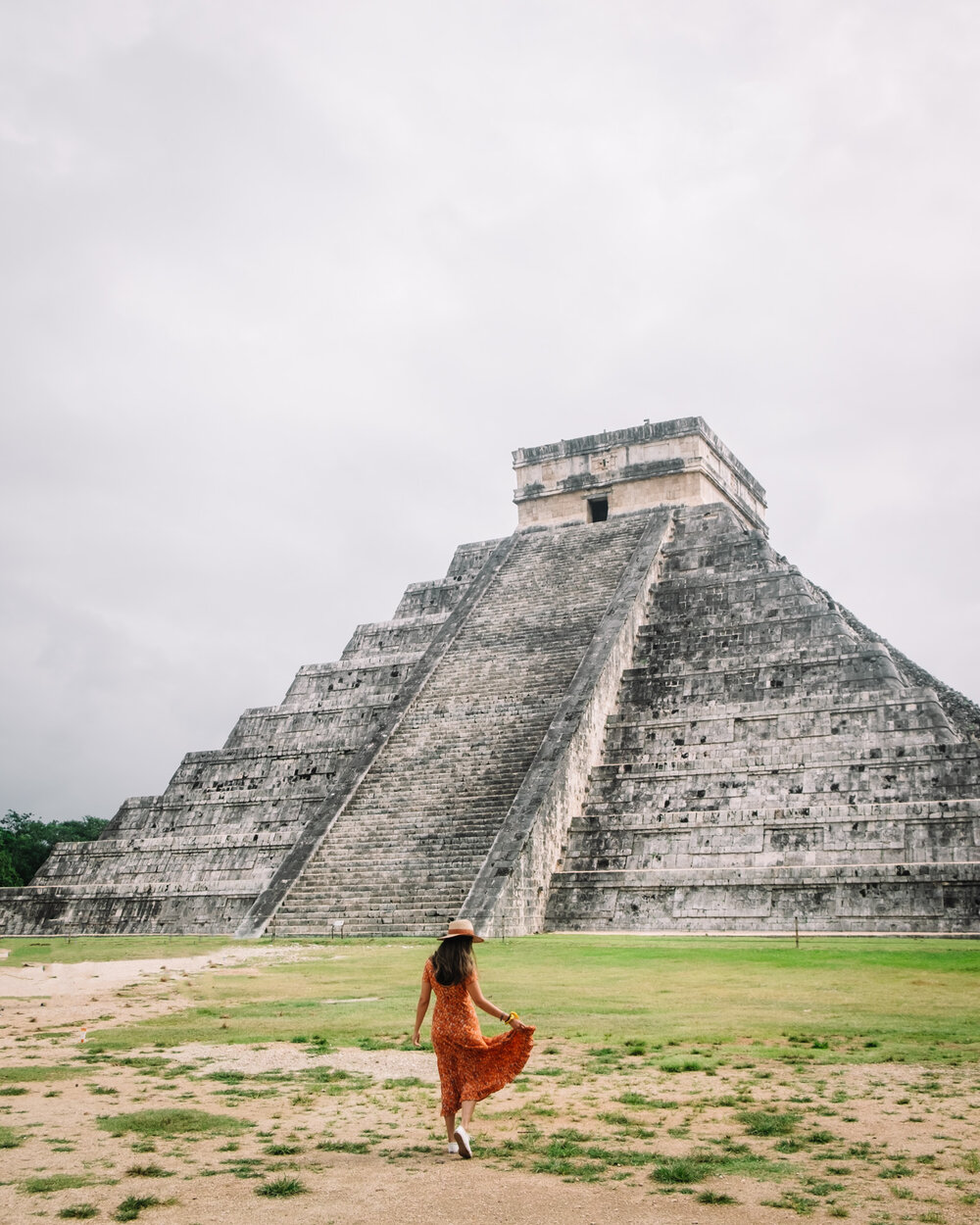Rachel Off Duty: A Woman Stands in Front of the Kukulkan Pyramid at Chichen-Itza, Mexico