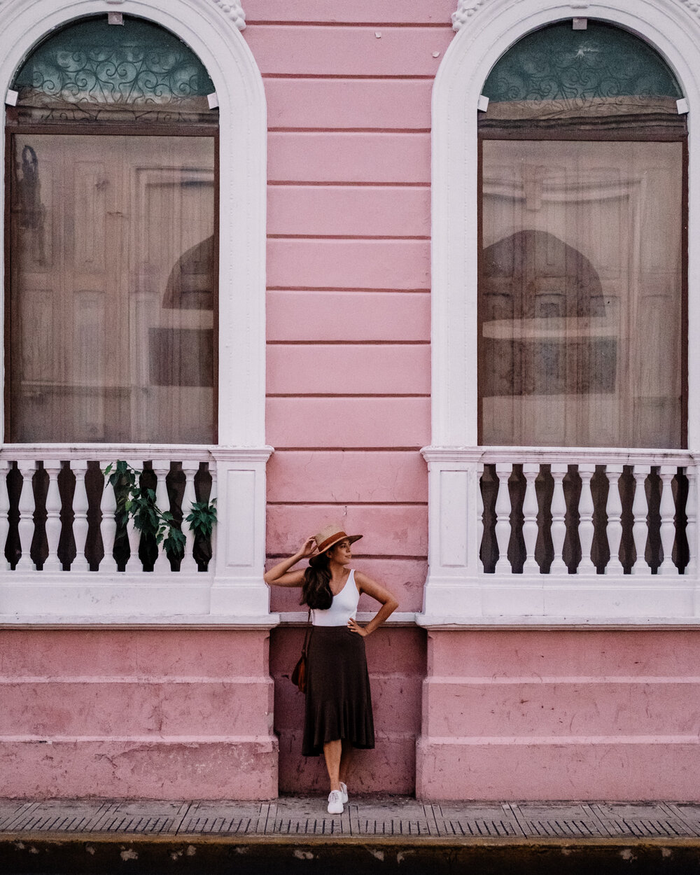 Rachel Off Duty: A Woman Standing in Front of a Pink Colonial Building in Merida, Mexico