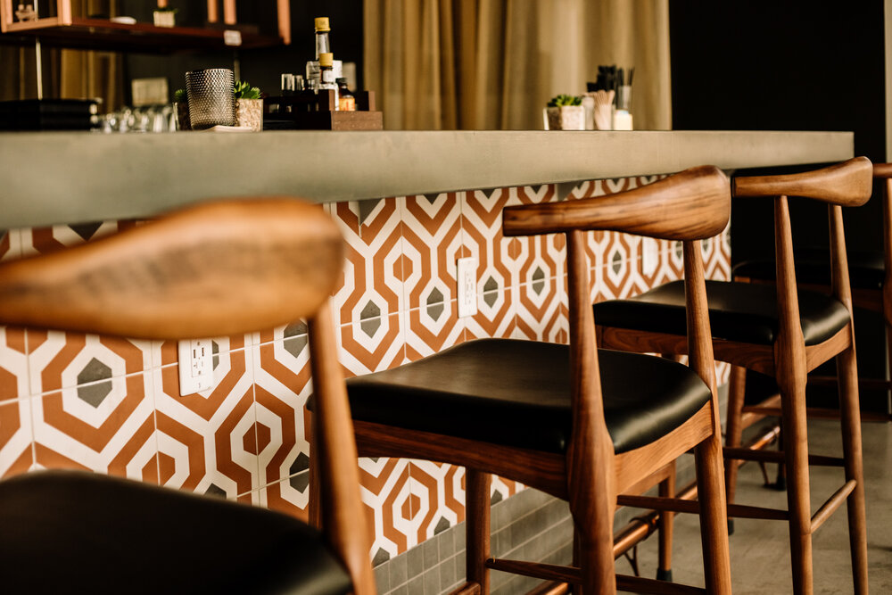 Rachel Off Duty: Bar Chairs and Bar with Patterned Tiles