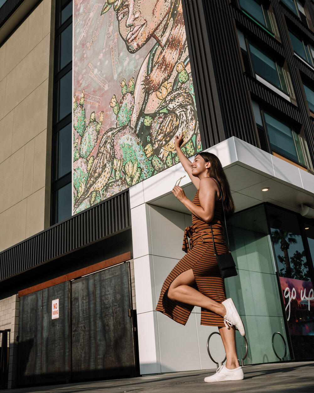 Rachel Off Duty: A Woman Posing in Front of the Exterior Murals at the Cambria Hotel in Phoenix, Arizona