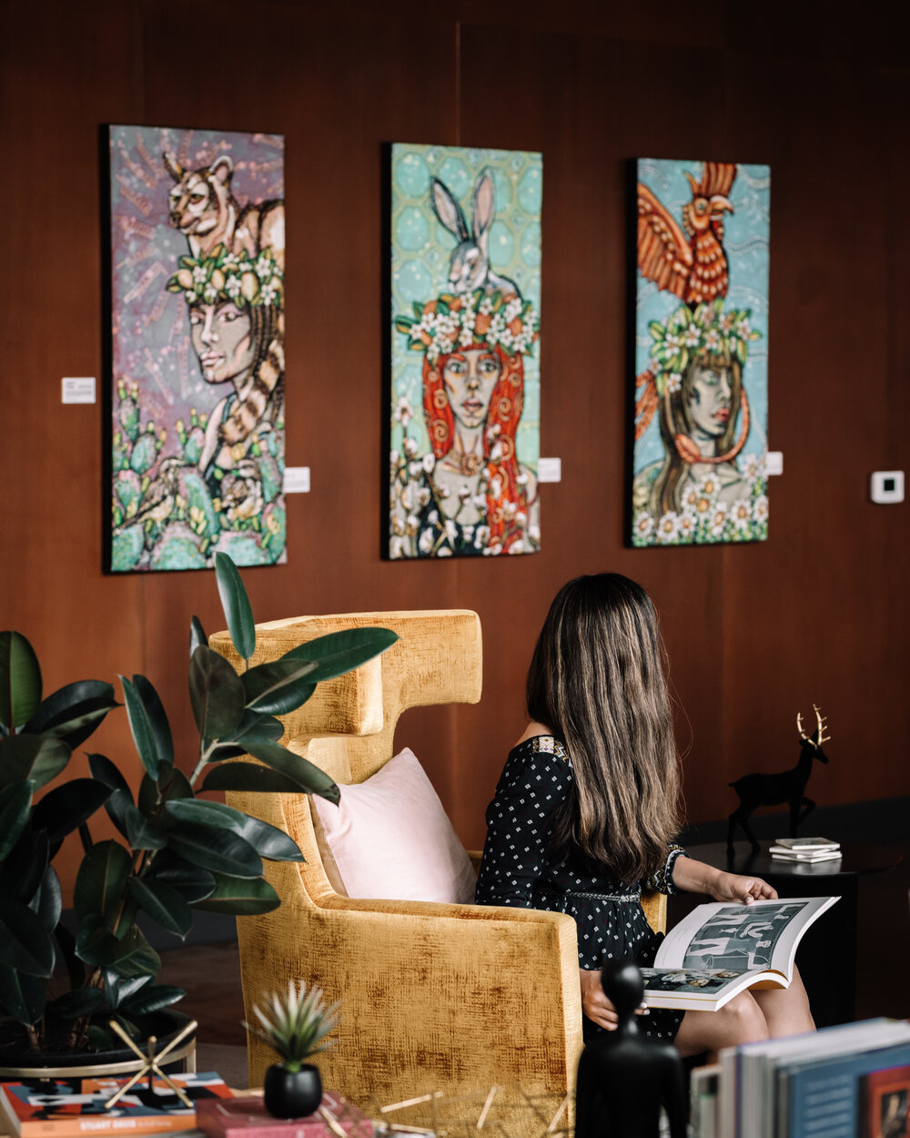 Rachel Off Duty: A Woman Reading in a Hotel Lobby with Art on the Walls