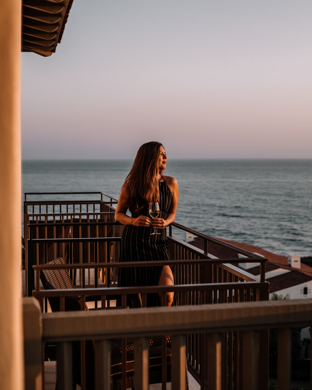 Rachel Off Duty: Woman Having a Glass of Wine at Sunset on a Balcony