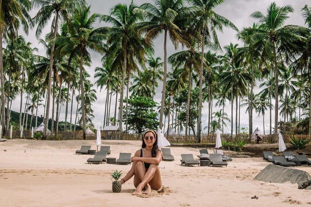 Rachel Off Duty: A Woman Sitting on the Beach in the Philippines
