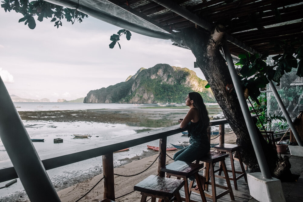 Rachel Off Duty: Woman Looking at the View from Outpost Beach Hostel, El Nido
