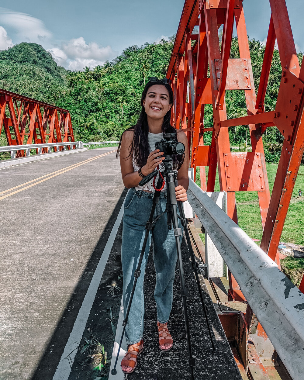 Rachel Off Duty: Woman on a Bridge with a Camera in the Philippines