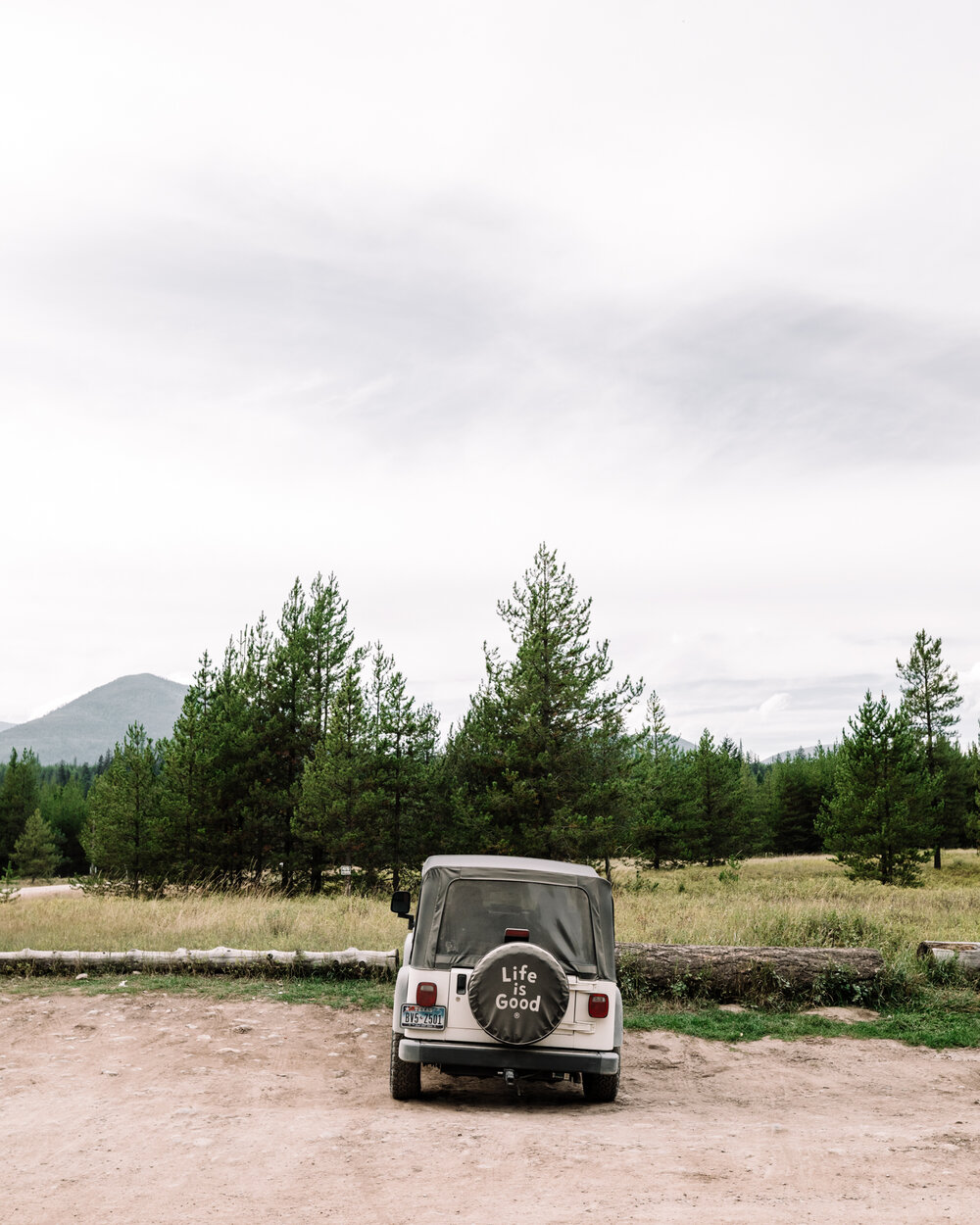 Rachel Off Duty: Jeep in Front of Trees in Glacier National Park