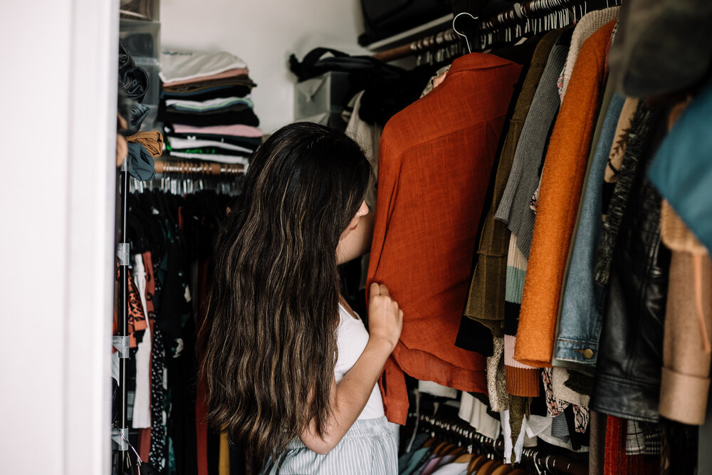 Rachel Off Duty: Girl Standing in a Closet Looking at Clothes
