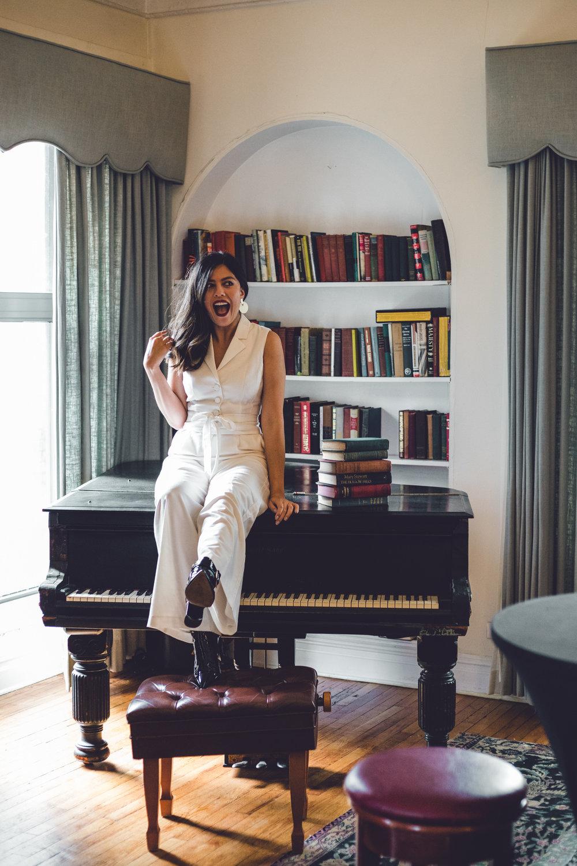 Rachel Off Duty: Woman Sitting on a Piano