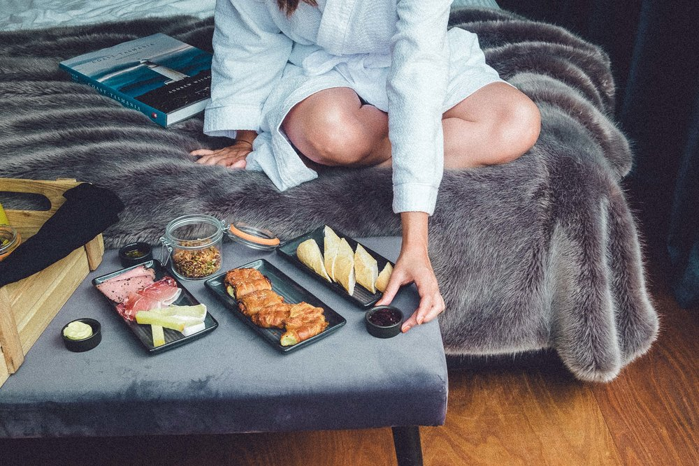 Rachel Off Duty: Woman Eating on the Bed