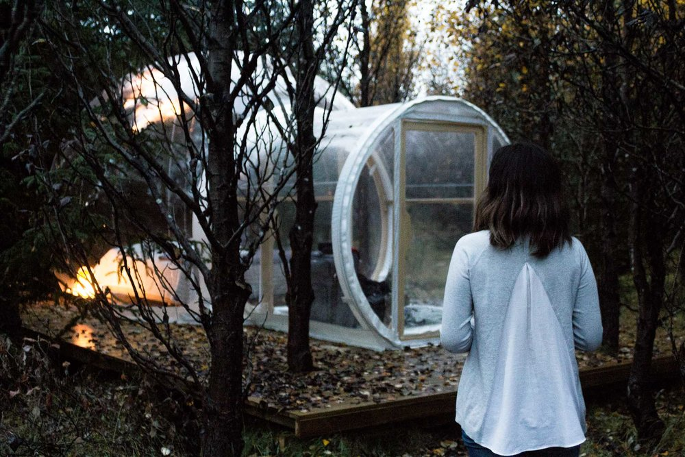 Rachel Off Duty: Woman in Sweater Stands in Front of Bubble