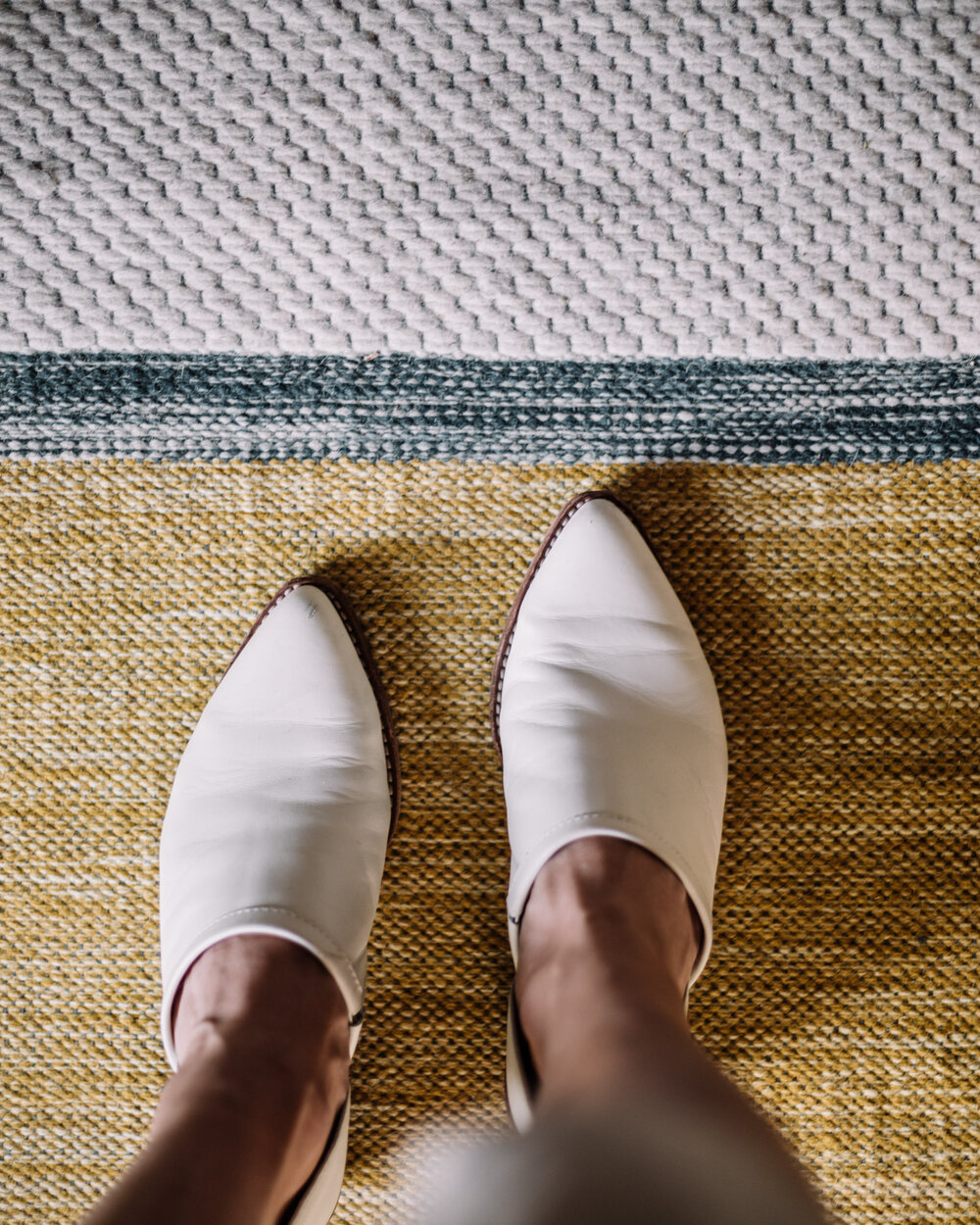 Rachel Off Duty: White Shoes on a Yellow Rug