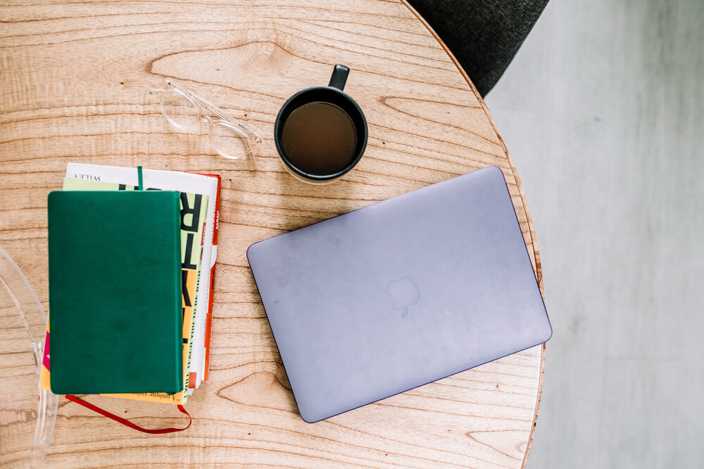 Laptop, Glasses, Coffee Cup and Books on a Wooden Table - Rachel Off Duty