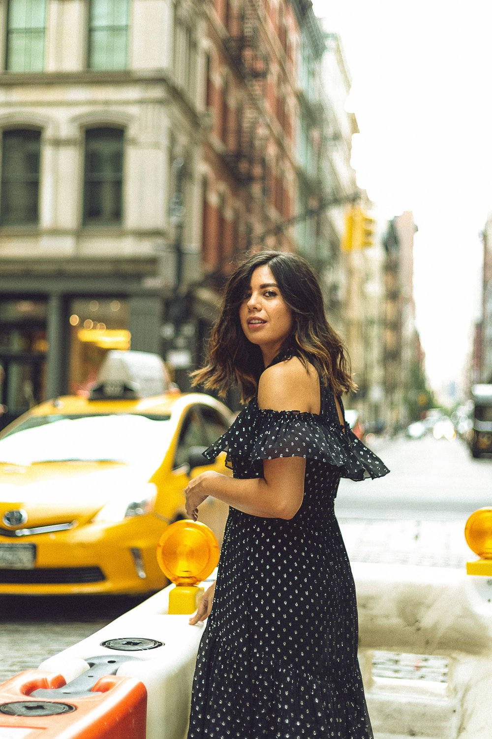Rachel Off Duty: A Woman Poses in Front of NYC Yellow Cabs