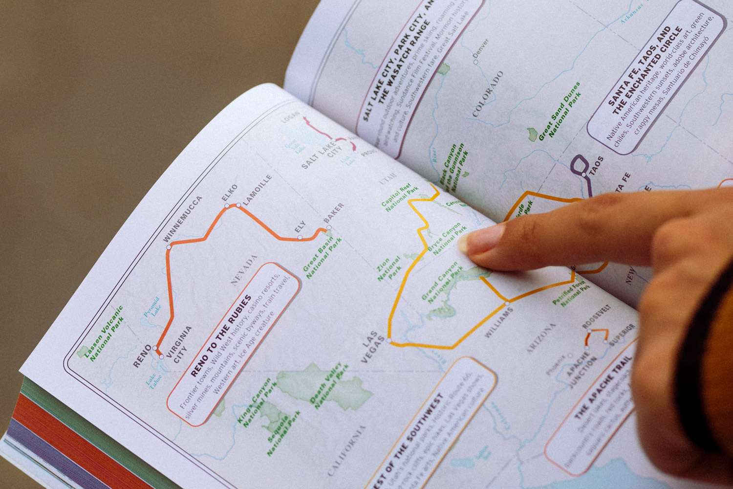 Rachel Off Duty: Pointing at A Road Trip Route in a Guidebook
