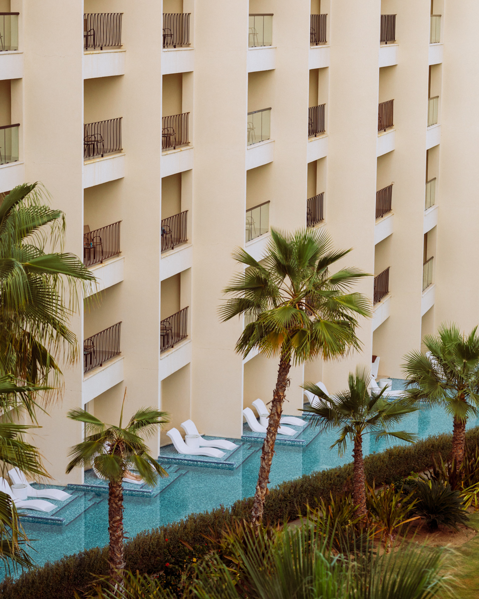 Rachel Off Duty: A White Hotel Facade with a Wrap-Around Pool