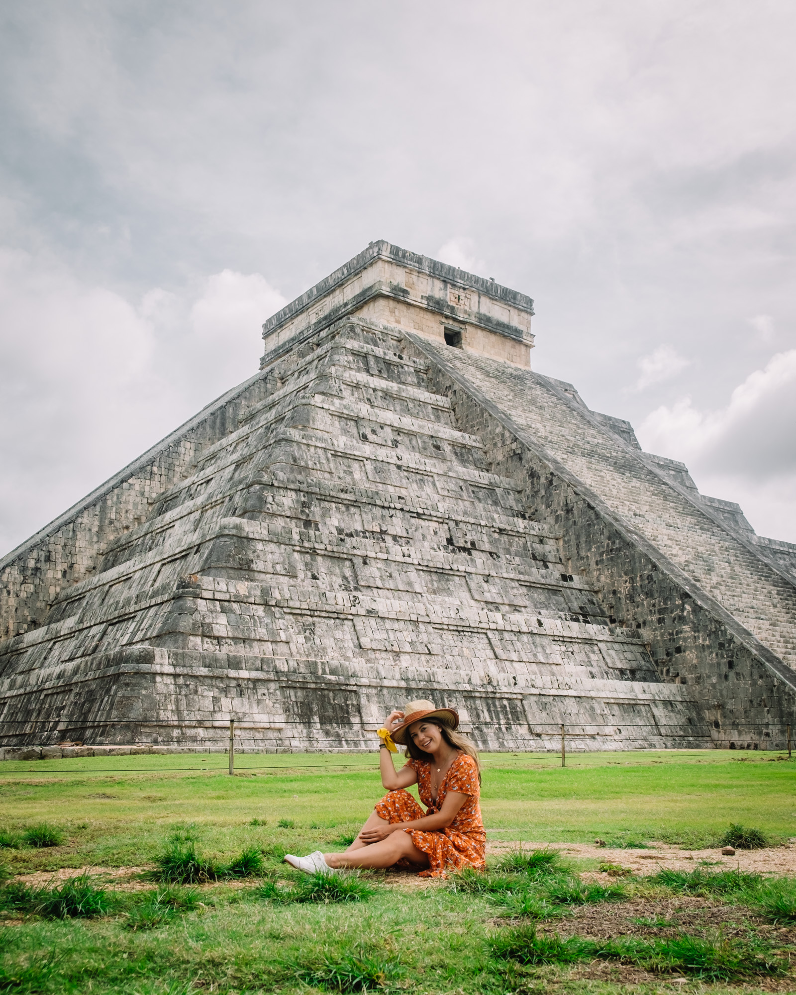 Rachel Off Duty: A Woman in a Red Dress Sitting in Front of Chichen-Itza, Mexico