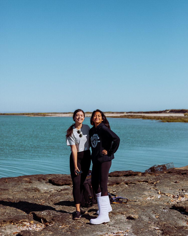 Rachel Off Duty: 2 Women Pose for a Picture in Front of the Ocean