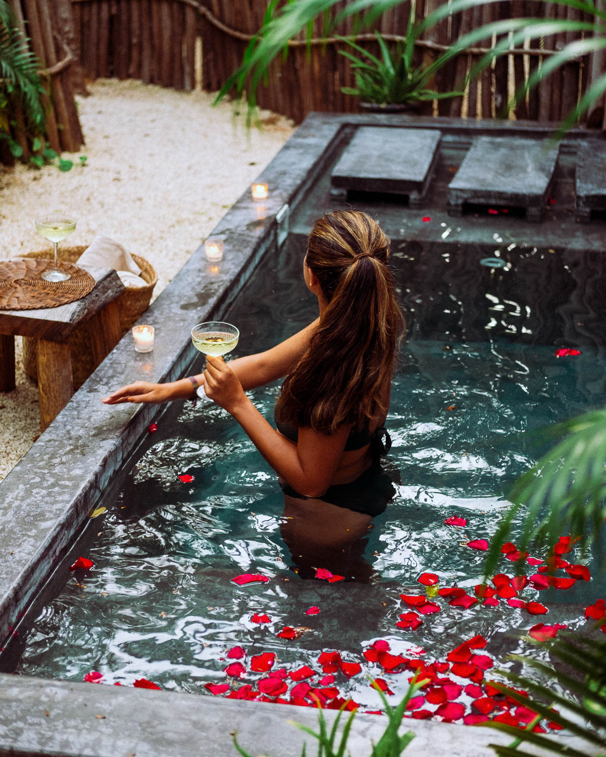 Rachel Off Duty: A Woman in a Pool with Rose Petals, Candles, and Champagne