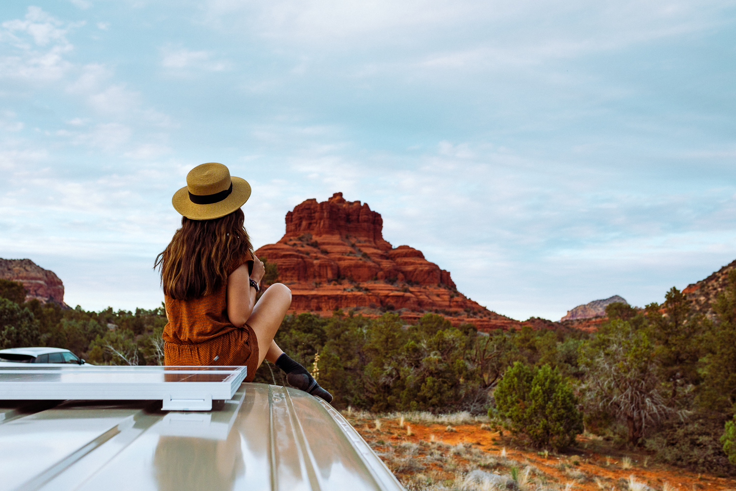 Rachel Off Duty: A Woman Sits on a Campervan in Sedona, USA