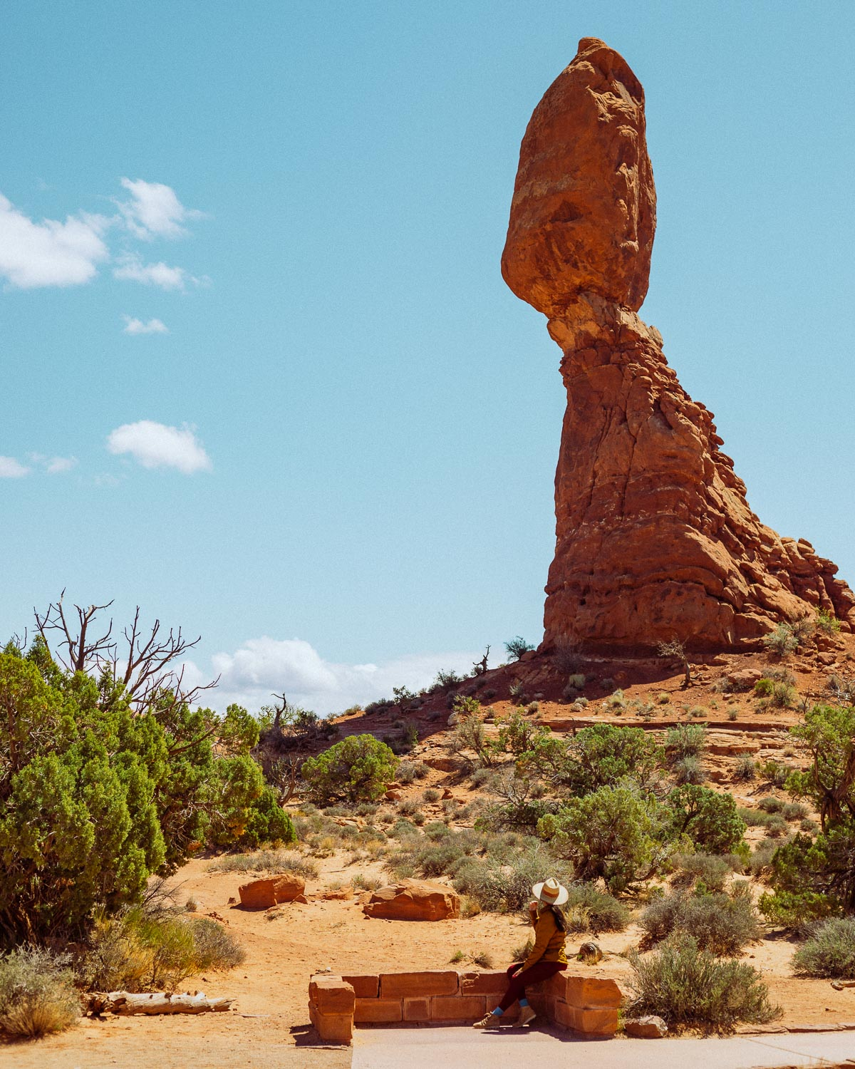 Rachel Off Duty: A Woman Looks Up at Balanced Rock in Arches National Park