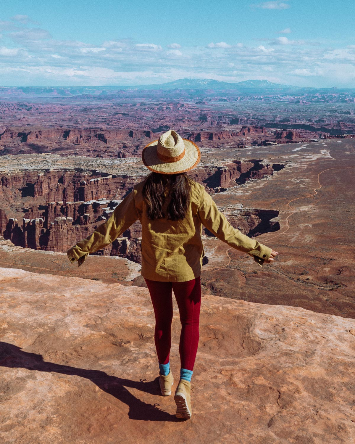 Rachel Off Duty: A Woman in a Khaki Jacket and Red Yoga Pants Admires the View at Canyonlands