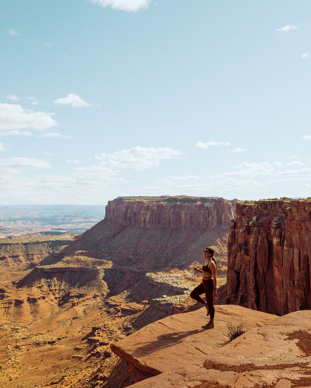 Rachel Off Duty: A Woman in Red Hiking Clothes Posing with One Knee Bent at Canyonlands National Park